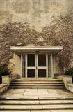 Ivy on college building. Sepia exterior of college building door with ivy covered wall Stock Photography