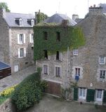 Ivy-covered stone houses, France. Royalty Free Stock Image