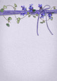 Ivy and lavender ribbon with bow Stock Image