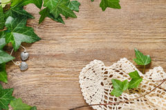 Ivy leaves on a wooden background. Graphic resources Stock Image