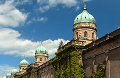 Ivy wall and cupolas of Mirogoj cemetary. Red bricks, green vine and copper corroded green domes on neo-renaissance wall of Mirogoj cemetery, Zagreb, Croatia Royalty Free Stock Photo
