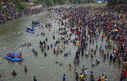 Iwak interspace festival Serayu. Thousands of people throw themselves and scrambling to catch fish in Serayu Banjarnegara, Central Java, August 30, 2015. Parak Royalty Free Stock Images