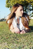 Iwoman on the grass n the park Royalty Free Stock Photo