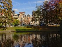 Ixelles lakes with autumn trees and houses in art nouveau style stock photos