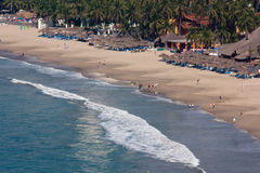 Ixtapa beach. Landscape with little people Royalty Free Stock Photos