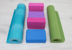 Iyengar yoga props blocks, strap, roller and carpet. Varicoloured iyengar yoga props blocks, strap, roller and carpet Stock Photo