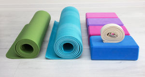 Iyengar yoga props blocks, strap, roller and carpet Stock Photo