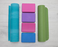 Iyengar yoga props blocks, strap, roller and carpet Royalty Free Stock Photography