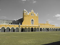 Izamal Yellow Church with Black & White Sky. Izamal Yellow Church with Green Grass and Black & White Sky - Mexico - Yucatan Royalty Free Stock Photo