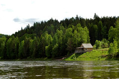 Izba on the Siberian mountain taiga and river Mana Stock Images