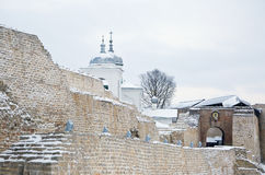 Izborsk fortress in winter, the entrance and the St. Nicholas Ca Stock Image