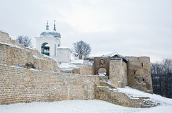 Izborsk fortress in winter, the entrance and the St. Nicholas Ca Stock Photos