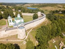 Izborsk medieval Russian fortress kremlin with a church. Aerial drone photo. Near Pskov, Russia. Birds eye view royalty free stock image