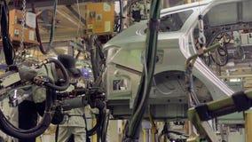 Izhevsk, Rusia - 15 de diciembre de 2018: Planta de fabricación producción del nuevo coche de LADA en la fábrica de automóvil AVT almacen de metraje de vídeo