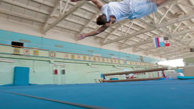 IZHEVSK, RUSSIA - MART 2014: Gymnast doing difficult stunts. IZHEVSK, RUSSIA - MART 2014: Three Axis Gimbal stabilized Gymnast doing difficult stunts. Acrobat stock footage
