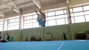 IZHEVSK, RUSSIA - MART 2014: Gymnast doing frontflip and backflip. IZHEVSK, RUSSIA - MART 2014: Three Axis Gimbal stabilized Gymnast doing frontflip and backflip stock video