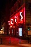 IZIS neon at night/Warsaw street stock photos