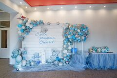One year boy party decorations with balloons and candy bar