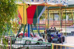 Outdoor play center for children with cars carousel or merry-go-round attrations. Entertainment concept