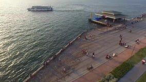 Izmir city center with coastline, ferries and fair. Turkish city, drone shot stock video