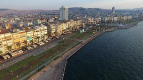 Izmir city center with coastline, ferries and fair. Turkish city, drone shot. Izmir city center with coastline, ferries and fair. Turkish city stock video footage