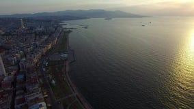 Izmir city center with coastline, ferries and fair. Turkish city, drone shot. Izmir city center with coastline, ferries and fair. Turkish city stock video