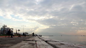 Izmir city, people walking, sea, clouds, turkey stock video footage