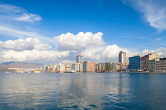 Izmir city, Turkey. Modern coastal city view. Coastal cityscape with modern buildings and mountains under cloudy sky. Izmir city, Turkey Royalty Free Stock Image