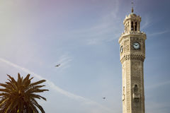 Izmir Clock tower. Clock Tower in Izmir Konak Square with a palm tree Stock Photography