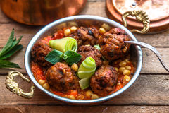 Izmir kofte - Turkish traditional meatball with chickpeas. tomato sauce and mint Royalty Free Stock Image