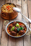 Izmir kofte, Turkish traditional meatballs in copper pan with spicy chickpeas Royalty Free Stock Photography