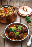Izmir kofte, Turkish traditional meatballs in copper pan with spicy chickpeas Stock Images