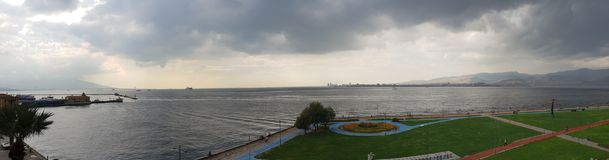 İzmir Smyrna Cumhuriyet Meydanı Deniz. Panoramic shot of Sea near Republic Square of İzmir Turkey. Tree, bicycle park and road, running way, Walking way Stock Photography