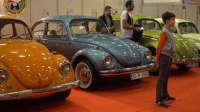 IZMIR, TURKEY, CAR EXHIBITION - OCTOBER, 2016: Legendary Volkswagen Beetle retro cars presented at cars exhibition fair. stock video