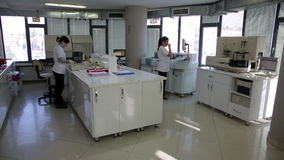 IZMIR, TURKEY - JANUARY 2013: Female scientists working in laboratory Royalty Free Stock Image