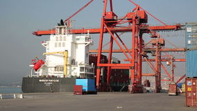 IZMIR, TURKEY - JANUARY 2013: Freight ship moored in harbour Stock Images