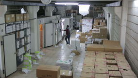 IZMIR, TURKEY - JANUARY 2013: Man working in storage room stock video footage