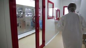 IZMIR, TURKEY - JANUARY 2013: Medical personnel passing through door Stock Photos