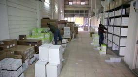 IZMIR, TURKEY - JANUARY 2013: Men working in storage room Royalty Free Stock Photo