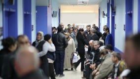 IZMIR, TURKEY - JANUARY 2013: People waiting in hospital corridor