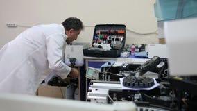 IZMIR, TURKEY - JANUARY 2013: Preparing laboratory equipment Stock Photo