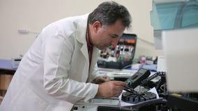 IZMIR, TURKEY - JANUARY 2013: Preparing laboratory equipment Royalty Free Stock Images