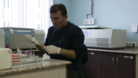 IZMIR, TURKEY - JANUARY 2013: Testing blood samples in lab stock video footage