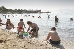 Beach in Izmir , Turkey. Izmir, Turkey - July 16, 2016: Izmir`s Seferihisar coast, is a beautiful place to relax and swim. Turks and tourists are enjoying the Stock Image