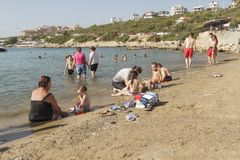 Beach in Izmir , Turkey. Izmir, Turkey - July 16, 2016: Izmir`s Seferihisar coast, is a beautiful place to relax and swim. Turks and tourists are enjoying the Stock Photo