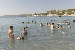 Beach in Izmir , Turkey. Izmir, Turkey - July 16, 2016: Izmir`s Seferihisar coast, is a beautiful place to relax and swim. Turks and tourists are enjoying the Stock Photography