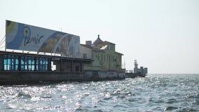 IZMIR, TURKEY - JULY 2015: Izmir's symbol Pasaport ferry station and Izmir title stock footage