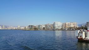 Beautiful view of Izmir city from a ferry in Aegean sea. Izmir, Turkey - 06 October, 2017: Cityscape of Izmir from a boat trip on a sunny day stock video footage