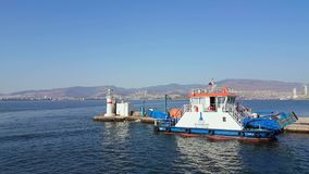 Beautiful view of Izmir city from a ferry in Aegean sea. Izmir, Turkey - 06 October, 2017: Cityscape of Izmir from a boat trip on a sunny day stock footage