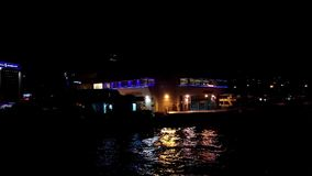 View of Karsikaya ferry pier at night. Izmir, Turkey - 06 October, 2017: Night view of Karsikaya pier from a ferry trip stock video
